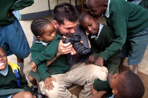 Bryce covered in kids at St. Timothy's in Moshi, Tanzania.